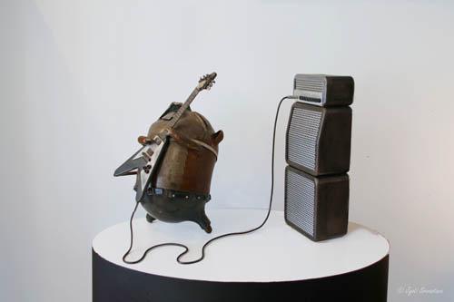 Hamster playing guitar – by Erik Lowe