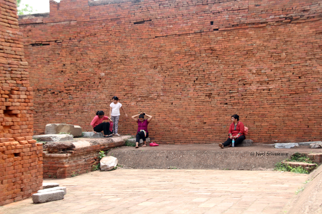 Relaxing on Teacher's Platform /  Archaeological Site of Nalanda University /  Nalanda, Bihar.