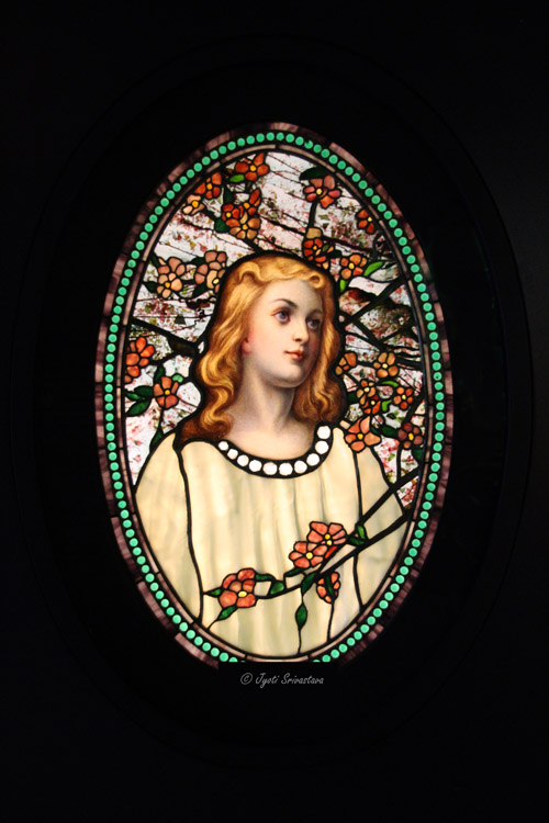 Girl with Cherry Blossoms – by Tiffany Glass & Decorating Company