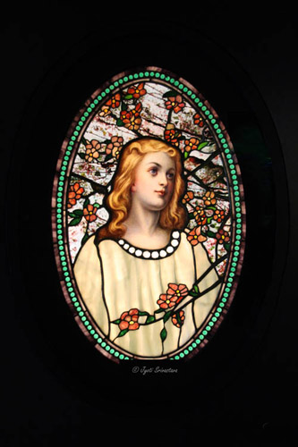 Girl with Cherry Blossom – by Tiffany Glass & Decorating Company