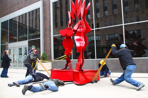 Installation of Flappers- by Ruth Migdal by CSI team-members for the Avenue of Sculpture, at Art Chicago, 2011.