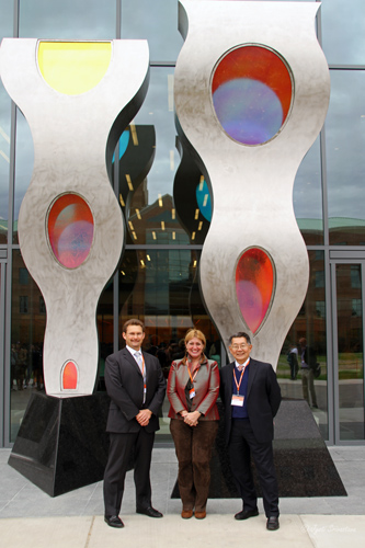 ECE professors John Dellasasse and Milton Feng with Nicole Beck