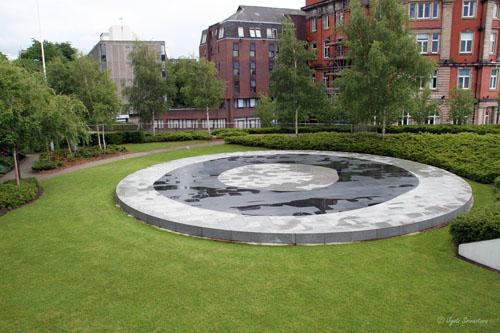 A circular stone sculpture by Susanna Heron create a reflective space in the Cathedral Garden.