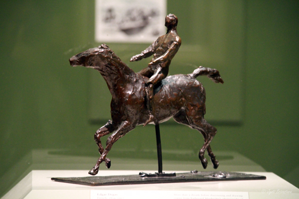 Horse with Jockey - Horse Galloping, Turning Head to the Right, Feet not Touching the Ground.