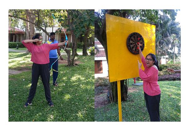 Rhea mastering archery at Radisson Blu, Mahabalipuram
