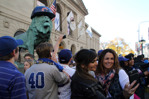 Art Institute Lions Don Cubs Caps for World Series / Cubs 2016 World Series Parade Day