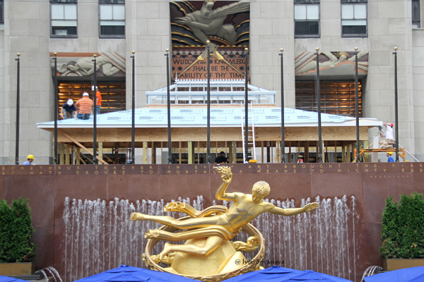 forground is statue of Prometheus, by Paul Manship.. and in the background is relief Wisdom, Sound and Light by Lee Laurie