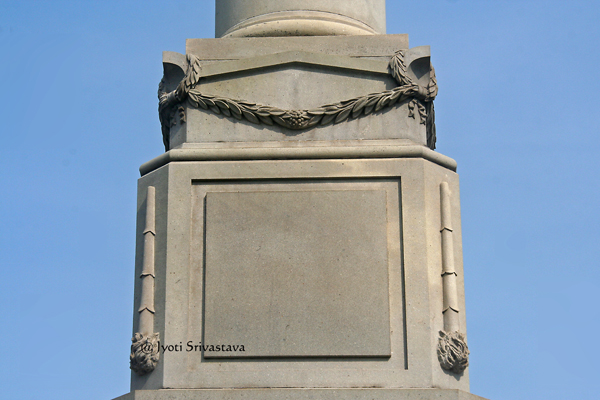 Upside down torch, symbolizing end of life.. / Tomb of Stephen A. Douglas
