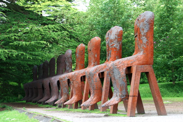 Ten Seated Figures - by Magdalena Abakanowicz