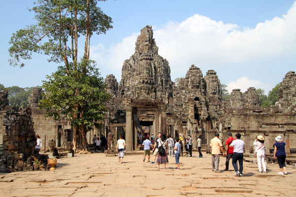 Gates of Angkor Thom lead to Bayon - capital of the walled city. / Siem Reap, Cambodia.
